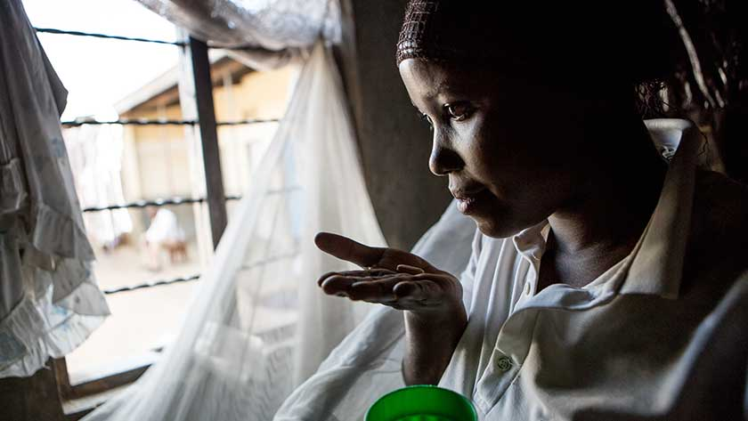 m2m client taking antiretroviral medication in Busesa, Uganda