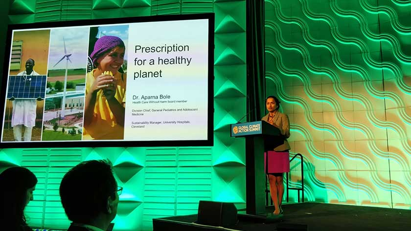 Dr. Aparna Bole, HCWH board member, presenting health care climate commitments at GCAS